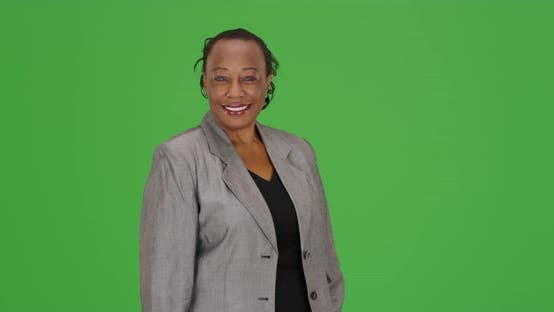 Thumbnail for An happy African American businesswoman smiles on green screen