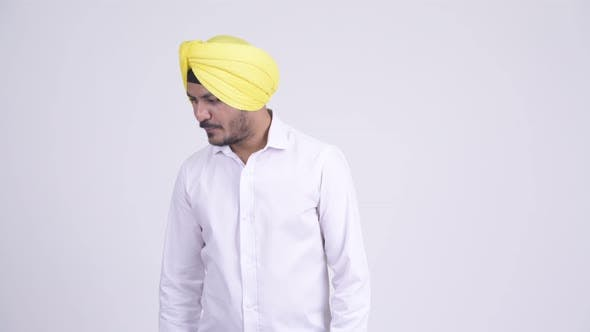Thumbnail for Serious Bearded Indian Sikh Businessman Thinking and Looking Down