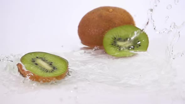 Thumbnail for A Several Slices of Kiwi are Falling on the Table