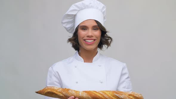 Cover Image for Happy Female Chef with French Bread or Baguette