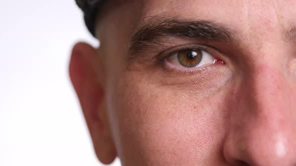 Extreme closeup of man's face and eye