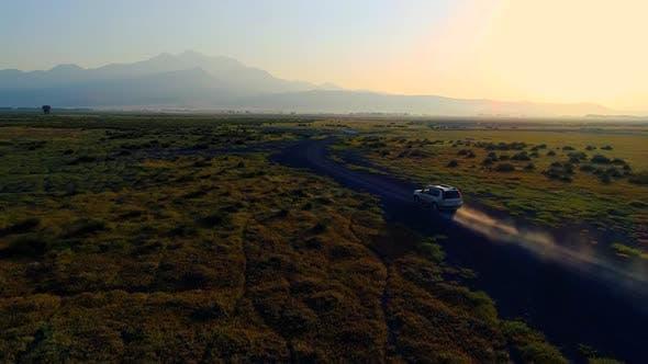 Thumbnail for Car Driving On Dirt Road Sun