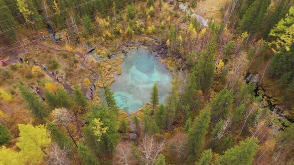 Thumbnail for Geyser Blue Lake Yellow Trees