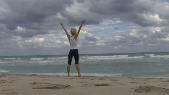 Thumbnail for Female practising yoga on a beach