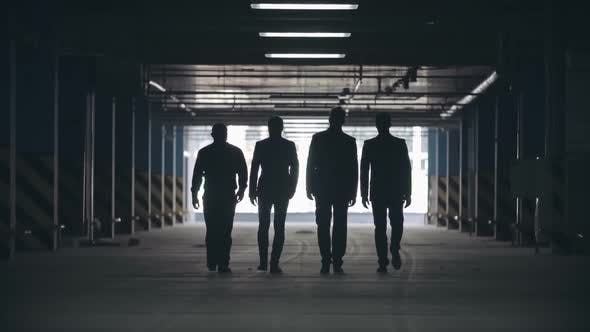 Thumbnail for Silhouettes of Four Men in Black Suits