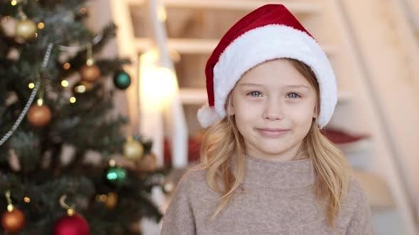 Little Girl in Santa Hat Smiling