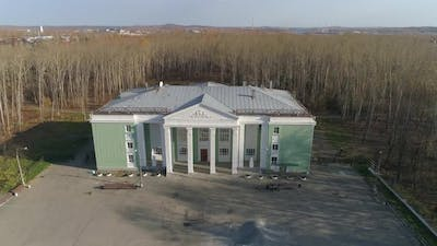 Aerial view of House of culture with columns with light green walls 02