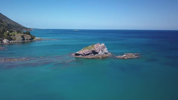 Thumbnail for Drone Is Flying Over Beautiful Rocks in Water of Mediterranean Sea Near Shore, Top View