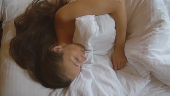 Woman Sleeping on Bed