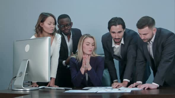Thumbnail for Group of Multiethnic Diverse Young Business People in a Meeting Standing Around a Table with Serious