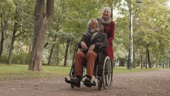 Thumbnail for Grandma on Walk with Disabled Grandpa