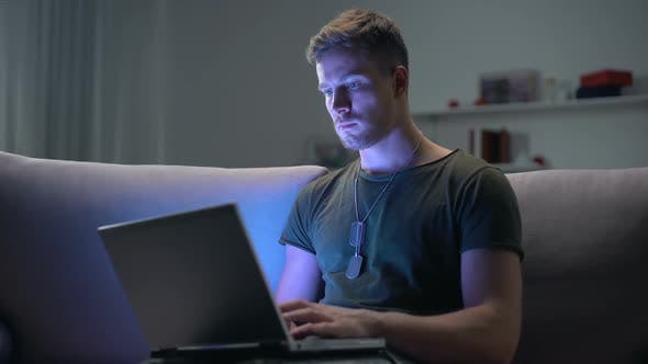 Serviceman Searching Job on Laptop at Home, Adapting to Civilian Life After Army