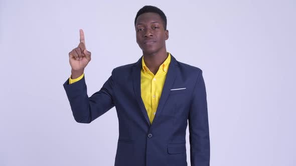 Young Happy African Businessman Pointing Up