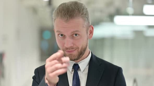 Thumbnail for Portrait of Assertive Businessman Pointing with Finger and Inviting