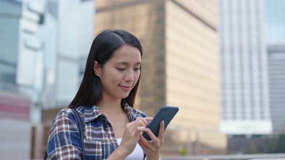 Thumbnail for Woman Use of Mobile Phone for Text Message in City