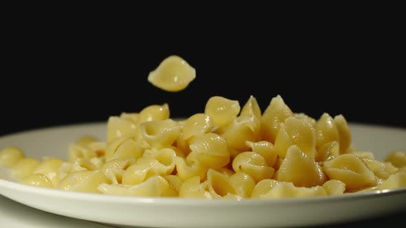 Thumbnail for SLOW MOTION: Cooked Conchiglie Fall Into Full Plate