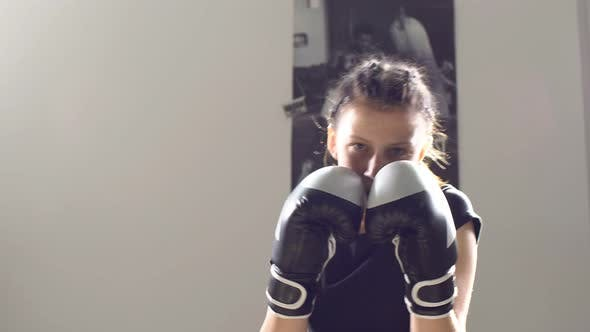 Thumbnail for Portrait of a Teen Girl Boxer Working Out the Bumps in the Ring