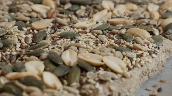 Thumbnail for Healthy whole integral wheat bread  with other cereals shallow DOF 4K 2160p 30fps UltraHD footage -