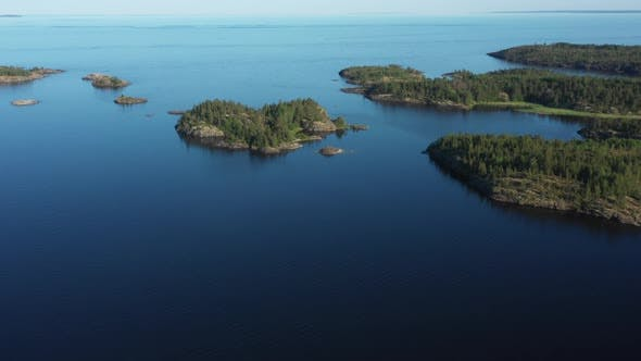 Aerial view on the lake and Islands with rocky coastline and forest in Karelia
