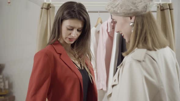 Thumbnail for Portrait of Stylish Client Trying on Jacket in Atelier