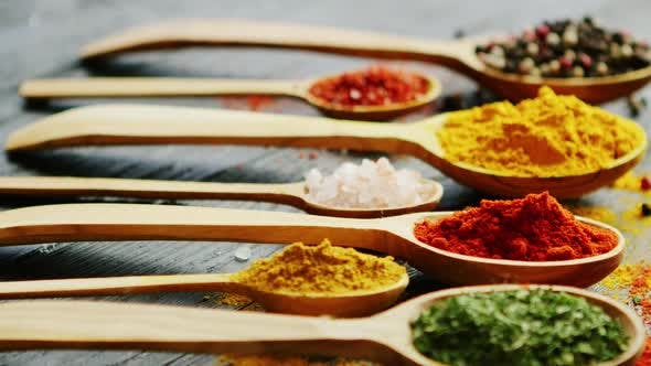 Spoons with Assorted Spices on a Table