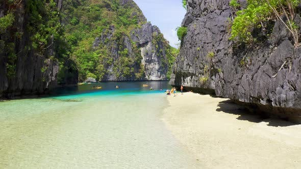 Thumbnail for Kayaks in the Big Lagoon with Turquoise Clean Water, Tropical Forest, Rocks in El Nido Island