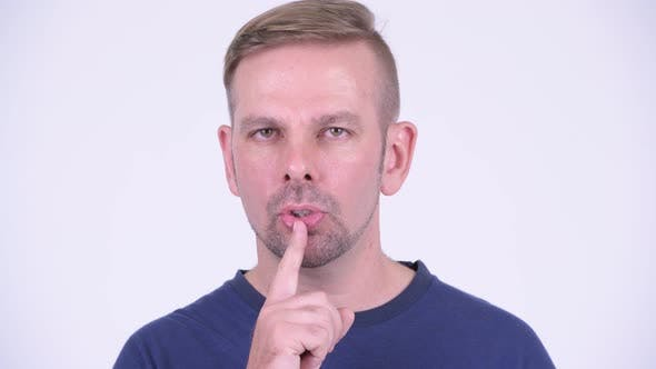 Cover Image for Portrait of Happy Blonde Man with Finger on Lips