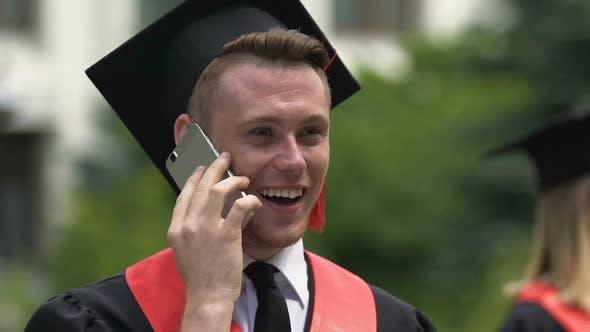 Surprised Graduating Student Having Phone Conversation Career Opportunities
