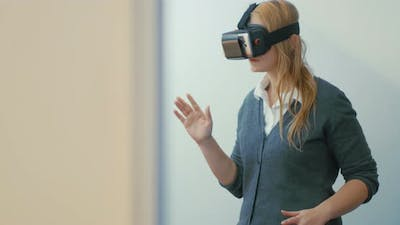 Woman entertaining with VR-headset for mobiles