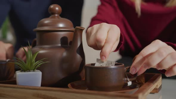 Thumbnail for Hands making a tea