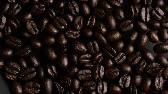 Thumbnail for Rotating shot of delicious, roasted coffee beans on a white surface