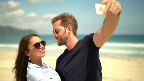 Couple Making Selfies on the Beach