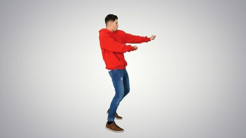 Young hip-hop man break dancing Top break dance on gradient