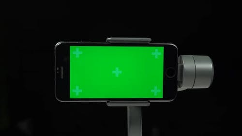 Steadycam Gimbal Stabilizer with the Green Screen on Mobile Phone