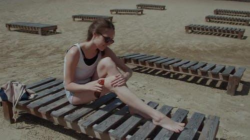 Sunscreen Woman Applying Suntan Lotion on Body During Summer