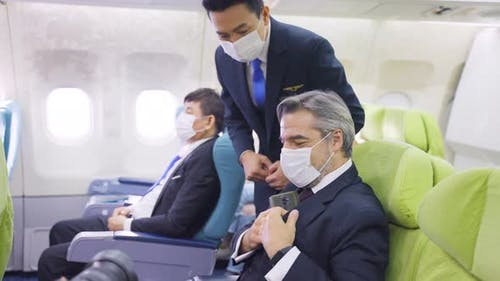 Steward take care and support business passenger, inform passengers to turn off electronic device.