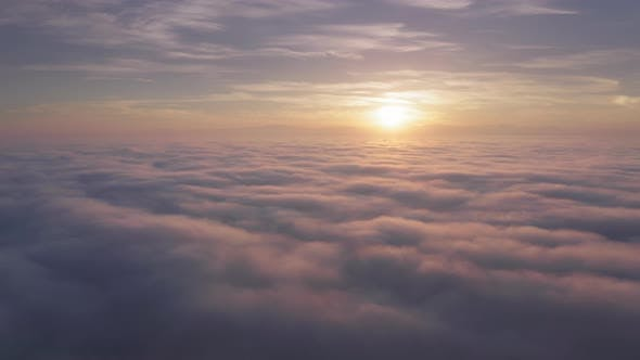 Thumbnail for Aerial Above Pink Clouds Above Mountain Top on Magical Golden Sunrise, USA