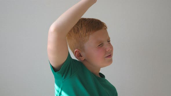 Thumbnail for Handsome Cute Kid Dancing with Raising Hands Indoor. Happy Male Child Closing His Eyes and Enjoy To