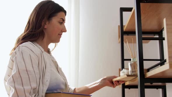 Thumbnail for Woman Placing Aroma Reed Diffuser To Shelf Home