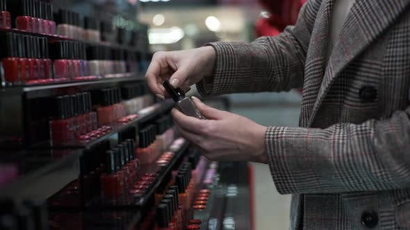Thumbnail for Buyer Female Chooses Nail Polish for Manicure and Pedicure From Large Number of Bottles of Nail