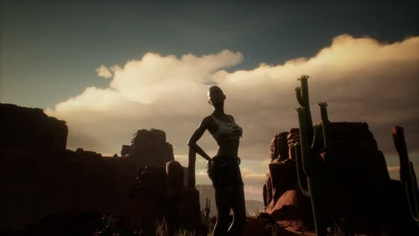 Thumbnail for Woman in Torn Shirt Standing By Cactus in Desert at Sunset