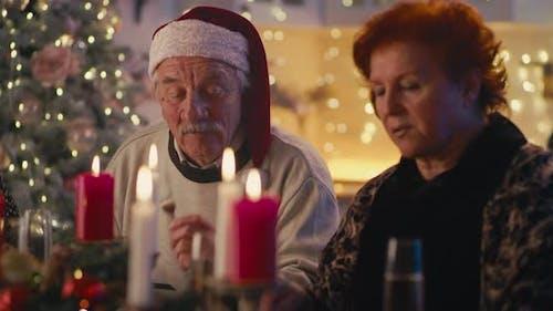 Senior Couple During Family Dinner on Christmas