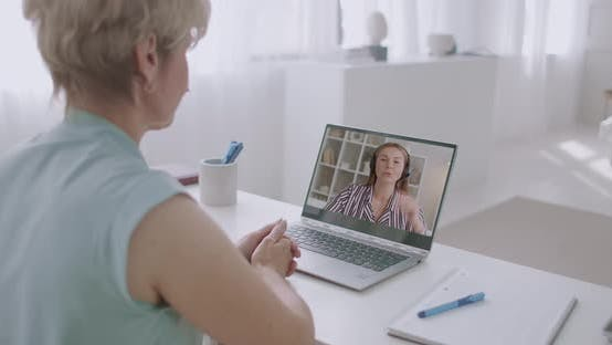Thumbnail for Two Women Are Chatting Online By Video Call on Laptop From Home, Talking and Gossiping