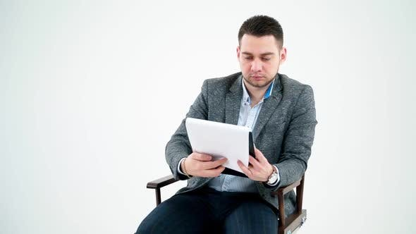 Thumbnail for Handsome businessman reading documents