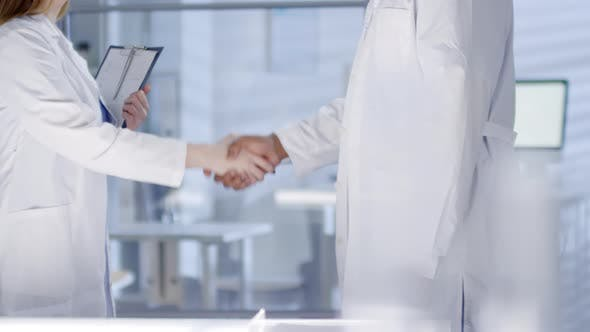 Thumbnail for Male Doctor Shaking Hands with Female Intern on First Day