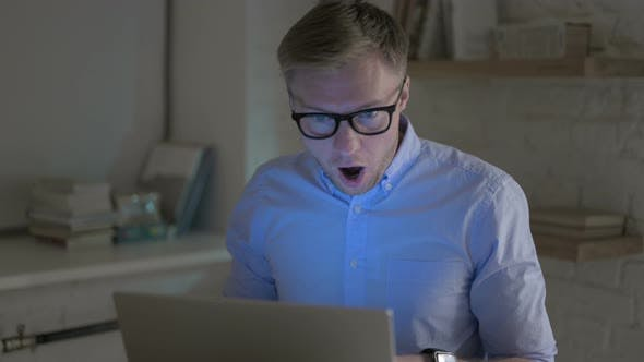 Thumbnail for Businessman Getting Shocked While Working on Laptop