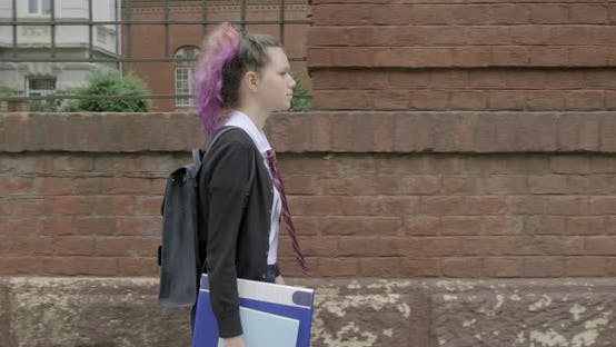 Cover Image for Teenager Girl in Uniform with Backpack Going To School