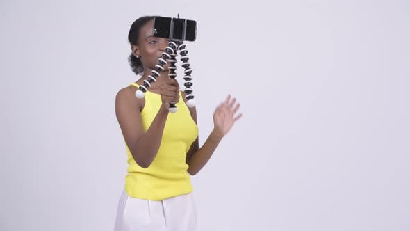 Thumbnail for Happy Young Beautiful African Woman Vlogging with Phone
