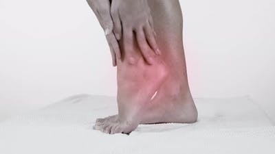 Heel Pain in Woman. Pain Concept
