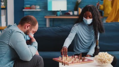 Mixed Races of Friends Moving Pieces on the Chessboard